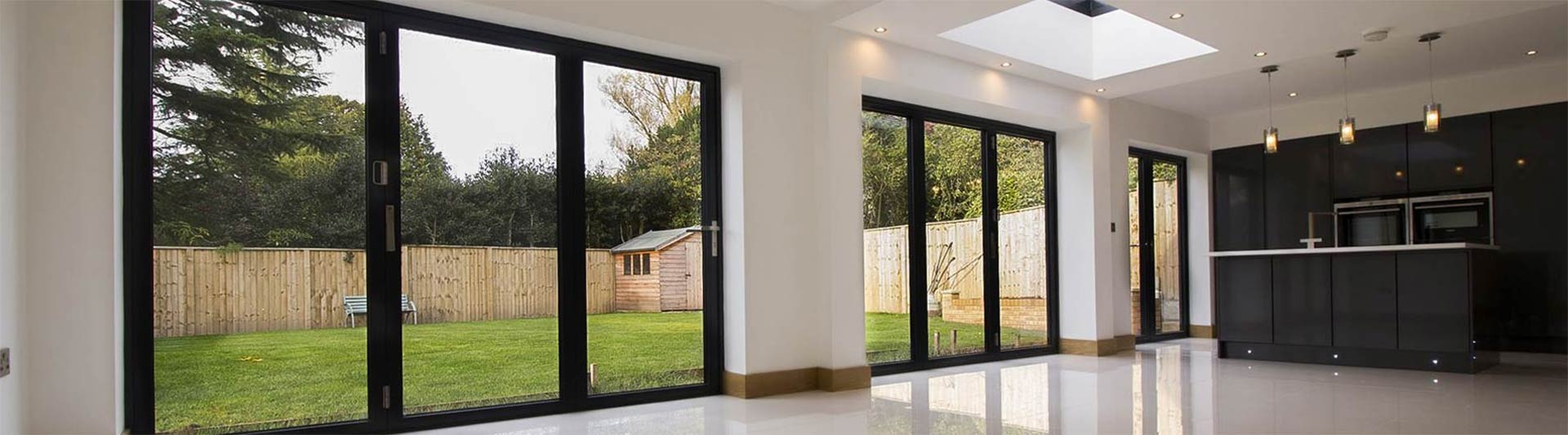 Installation of three sets of bifold doors to complete this multi use space in a new build home, Heswall.