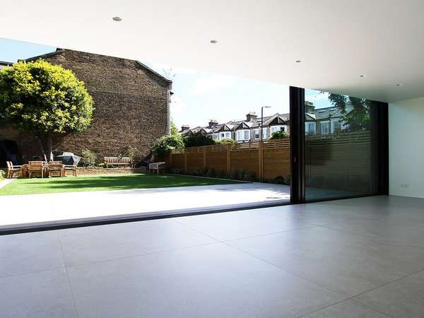 Triple Track Aluminium Slim line Sliding doors have arrived at John Knight glass. The Installtion of the Slim line Alumnium dors was carried out in Cheshire . Three doors slding gives the large opening needed on that sunny day, but also the large Glass pa