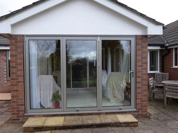 Aluminium bifold doors in a specialised RAL colour. Installed in Manchester.