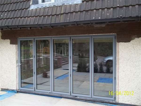 Mrs L: Caldy, Wirral: Installation of steel work and removal of brickwork to form opening. Classic S1 Bi Fold doors. Marine Finish Polyester Coated RAL colour 7031.