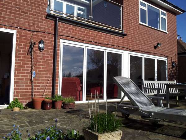 Nantwich, Cheshire: Installation of Classic S1 Aluminium Bi Fold Doors. Triple Glazed - U Value 1.0. Standard RAL White Colour.