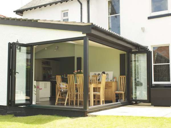 Heswall, Wirral: Installation of Slimfold A10 Aluminium Bi Fold doors - Double glazed - Matt finish, RAL colour 9017.