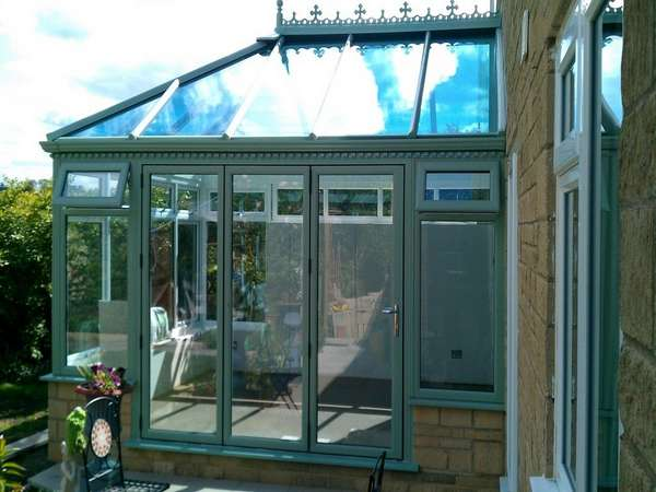 Blackpool : Design and build PvcU Conservatory showing K2 Sage foil roof glazed with Hytherm Self Clean Double glazed units. Matching Sage Green foil PvcU window and Classic S1 Bi fold doors double glazed with Hytherm self cleaning double glazed units.