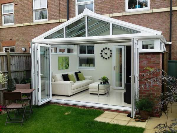 Mr D : WEST DERBY LIVERPOOL : Design and Build Conservatory. R70 PvcU Bi Fold doors - Double glazed manufactured Hytherm Insulative Glass. - Roof K2 with PvcU External Cappings glazed with Celsius one U Value 1.