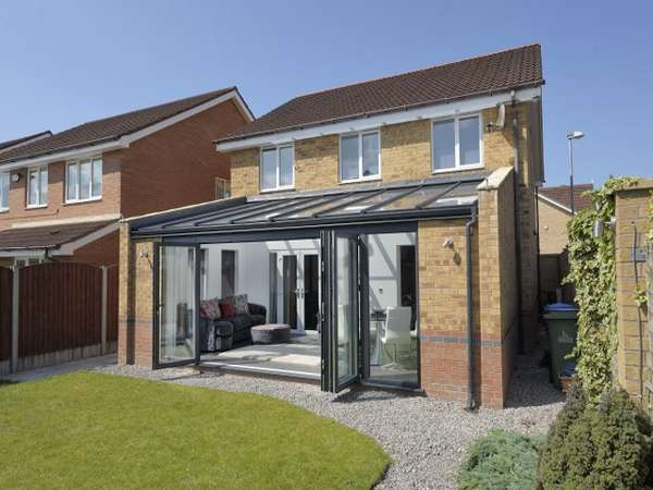 Warrington : Mr & Mrs D . Design and Build : Ultra Aluminium Capped roof system to Ral 5008 - Glazed with Celsius on roof glass Ug 1 . Bi Fold doors - Centor C1t Triple glazed with 44mm sealed units Ug .75