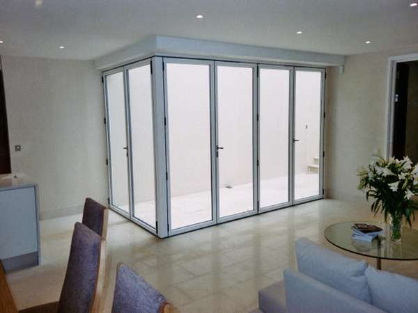 Altringham cheshire; Installation of FSD slimfold A10 Aluminium Bi fold doors - Std white with walk through threshold to form court yard