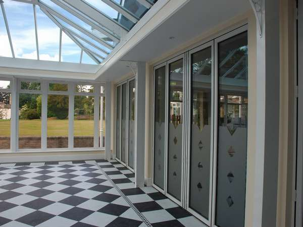 North Wales Mold - Installation of classic S1 White Aluminium Bi fold doors double glazed in a K2 Portal Conservatory - Glass Celsius one clear