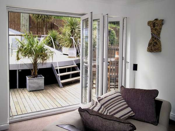 Hoylake, Wirral. Installtion of Slimfold AC10 White PvcU Bi folding doors. Double glazed with Hytherm Double glazed units