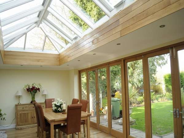 Cheadle Manchester. Internal view of a pair of G Barnsdale's Oak Bi Fold doors in there slimline section double glazed. Skylight HWL Ornate to complement the timber door. Marine Finish Aluminium with 4 no Rain censored Electric roof vents.