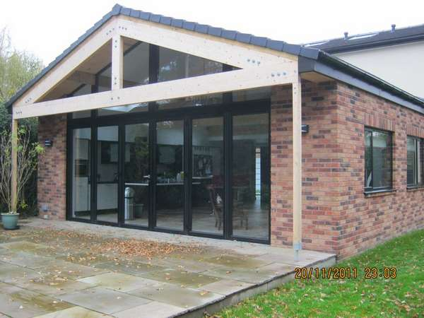 Mr S.: Hartford cheshire : 6m x 4m atrium window, Centor Aluminium Bi folding doors with 70mm - 300s Aluminium Frames. Double glazed with Pilkington Soft coat Low E Double glazed units, argon gas filled with warm edge spacer. structural steel over capped