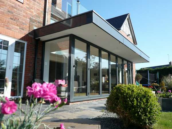 Caldy Wirral : Design and build - Centor C1 Bi fold doors - sarnafil roof cover. Aluminium Fascias