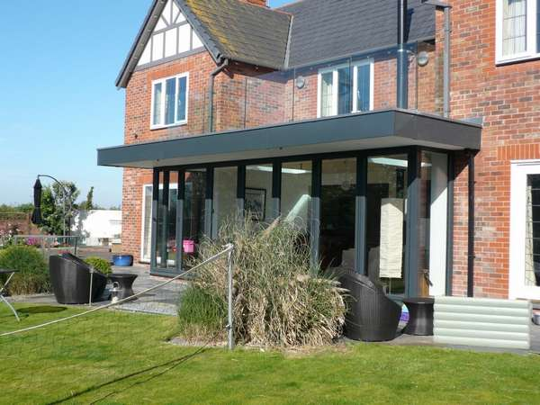 Caldy wirral : design and build: CLR Balustrade system 15mm heat-soak Toughened glazing: Centor C1 44mm triple glazed Bi fold doors
