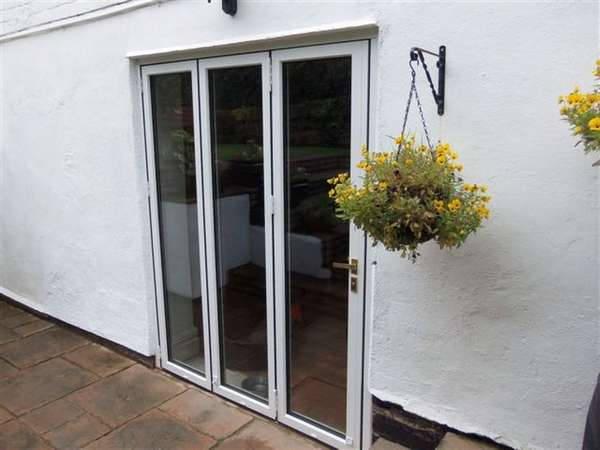Mr J. : Oxton Wirral. Installation of FSD Aluclad slimfold AC10 Bi fold doors; Oak internal - White Marine finish Aluminium external