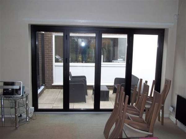 Mr & Mrs G . Heswall wirral : Installtion Alumnium Bi folding doors in satin Black. Marine Finish Alumnium . Poyester Powder Coated Centro C1 aluminium Bi-fold door triple glazing Bi fold door Chester CH1 near Wilmslow near Alderley Edge SK9. Aluminium