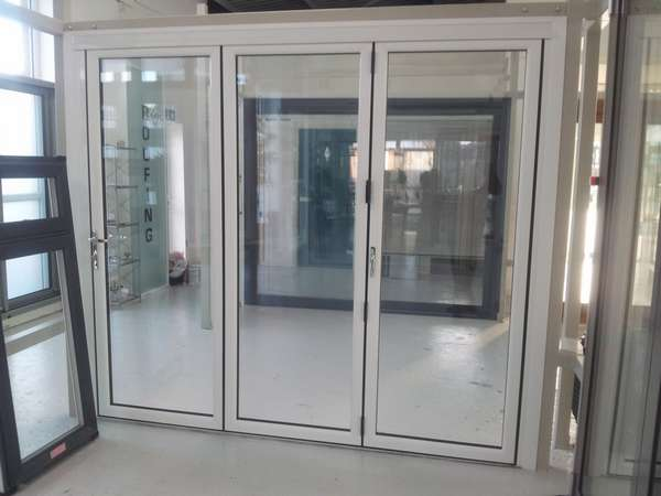 NEW PVCU - AlUMINIUM HYBRID Bi Folding door - Showroom photo. 135mm sight line. Flush floor - 28mm sealed units - 4 foil finishes. Grey . black. Chartwell Green- Cream. Can also be sprayed to any RAL