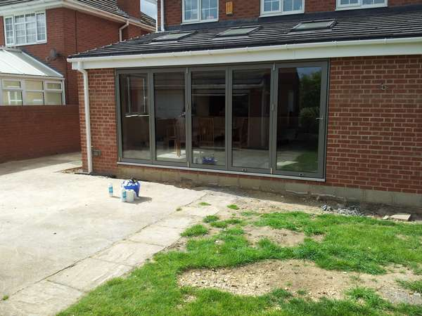 Warrington Cheshire Aluminium Bi folding doors by Centor. Triple glazed with 44mm Units Thermal U value .6 Artgon gas filled . Our Cheshire Bi fold window team would work with you to achieve the flush floor look that is so wanted.