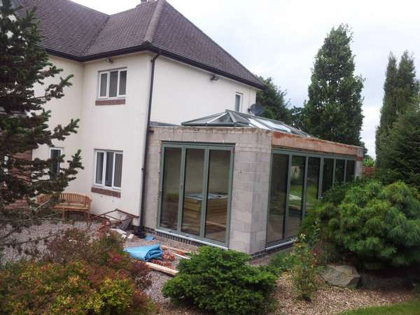 Mr B, Henbury, Cheshire : Orangery designed by FOB Architects Installation of Centor C1 Bi-fold doors with triple glazing and sprayed in RAL 7033 paint. Installation off an Aluminium spared ATS roof system with electric opening vents.