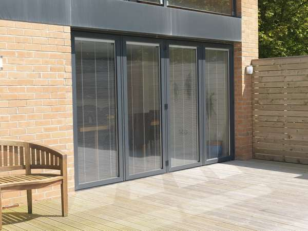 Slimfold A 10 Bi folding doors showing internal Blinds, maunually operating. Aluminium Bi fold doors Chester CH1 Aluminium Bi fold doors Curzon Park CH4