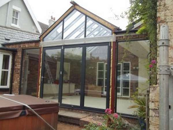 Mr & Mrs E, West Kirby, Wirral : Centor C1 double glazed Bi-fold doors with marine finish. With a combination Allstyle gable ended double glazed point. Aluminium spared ATS roof system with double glazed celsius glass.