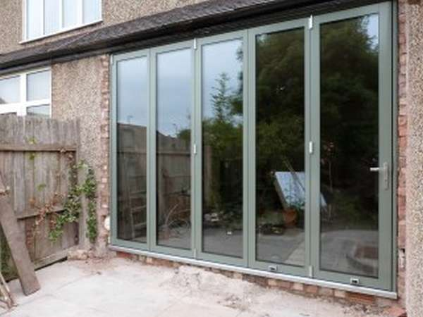 Mold North Wales - New Build extention of Centor C1 Bi fold doors triple glazed with 44mm units. Sating chrome threshold in a bespoke RAL to the Clients choice