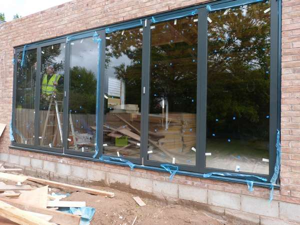 AKC Construction - New Development - Eyebrook Bowden Cheshire : Installtion of Centor C1t Bi Folding doors . Flush floor walk through Triple Glazed U value .6
