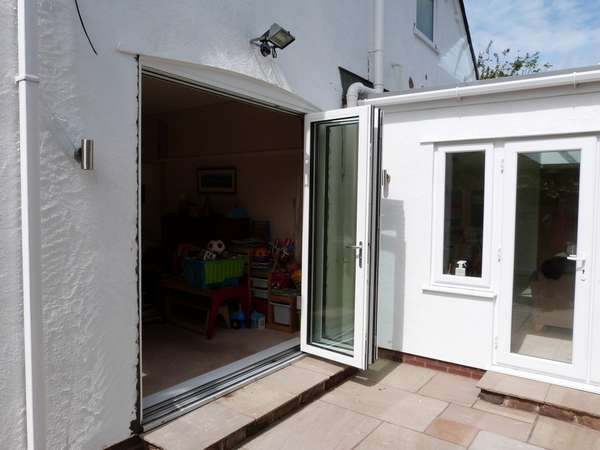 DAVENHAM , CHESHIRE : New Hybrid PvcU /Alumnium Bi Folding doors. Double glazed with 28mm