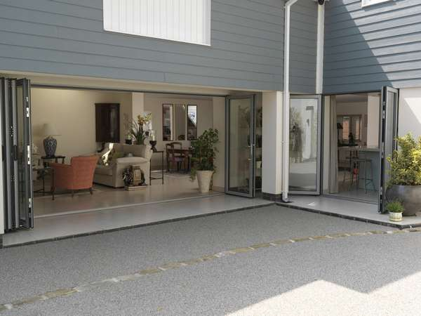 Mr & Mrs W: Chester: Design and Installation of Centor C1 44mm triple glazed Aluminum Bi Fold Doors