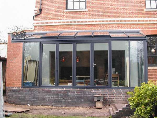 Mr D: Coventry: Instalation of Allstyle aluminium windows triple glazed in a marine finish polyester powder coating: Ral 7016: centor C1 triple glazed bifold doors with 44 mm units U Value 0.7