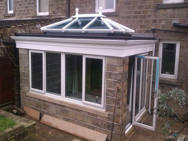 Doctor C: Ruthin North Wales : Design and |Biuld of an orangery showing a set Classic S1. Bi fold doors