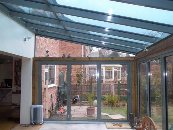 Mr V: Neston South Wirral. Installtion of 4 no Centor C1t Triple glazed Bi fold doors complete with HWL Thermally broken Roof