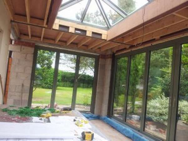 Mr B, Henbury, Cheshire : Internal view of Orangery designed by FOB Architects Installation of Centor C1 Bi-fold doors with triple glazing and sprayed in RAL 7033 paint. Installation off an Aluminium spared ATS roof system with electric opening vents.